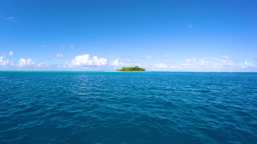 filmed island of a boat in french polynesia, tahiti