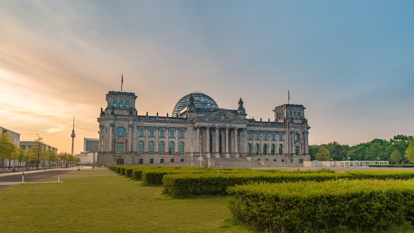 Berlin city skyline sunrise timelapse at Reichstag (German Parliament Building), Berlin, Germany, 4K Time lapse