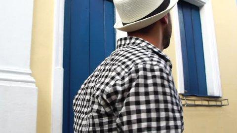 Young traveler walking and looking forward at Pelourinho, Salvador, Brazil