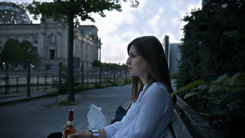 Young woman saying cheers and drinking wine in the Berlin city center hd | Shutterstock HD Video #31290331