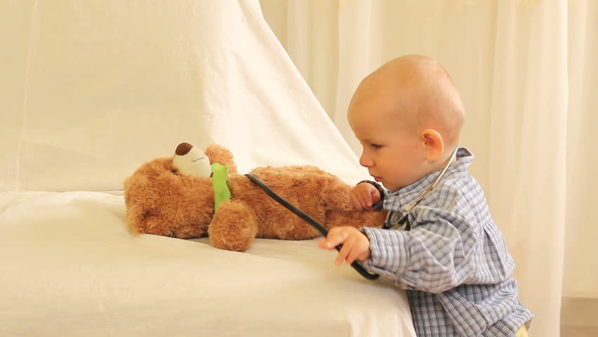 Little cute baby playing as doctor with its teddy bear toy #3133627