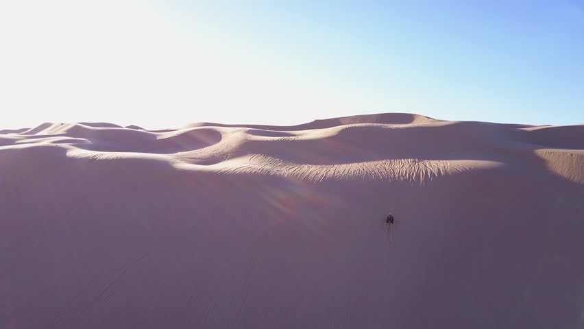 CIRCA 2010s - Imperial Sand Dunes, California - Dune buggies and ATVs race across the Imperial Sand Dunes in California.