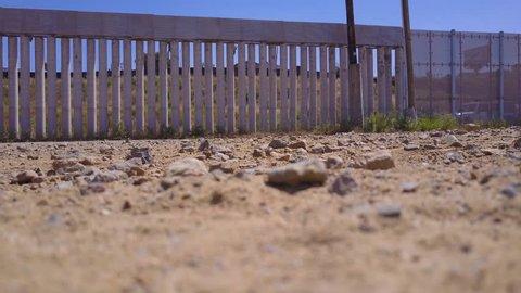 CIRCA 2010s - Tijuana, Mexico - A U.S. Border patrol vehicle passes the border wall near Tijuana, Mexico.
