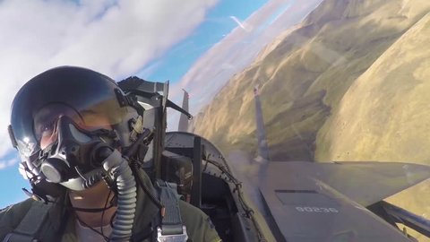 CIRCA 2010s - POV from inside of a fighter jet as it flies in formation.