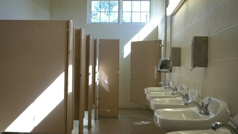 Establishing interior shot of empty public bathroom in the afternoon - ALT