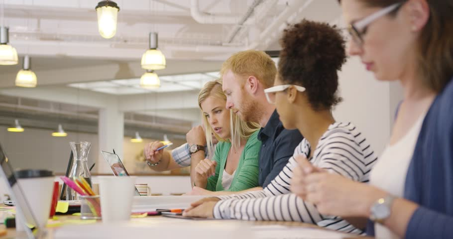 Diverse people posing in row at table on background of modern office and working all together with various documents. | Shutterstock HD Video #31385641