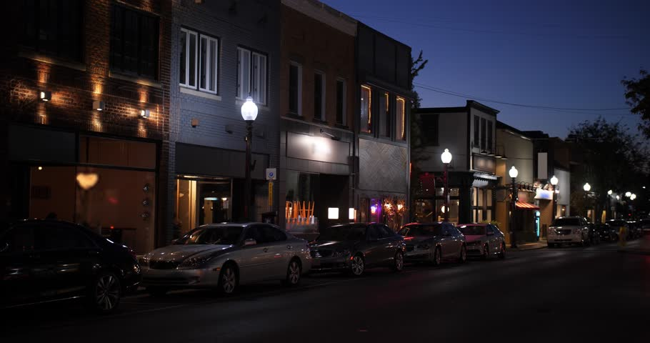 A nighttime establishing shot of businesses on a typical Main Street in America. Pittsburgh suburb.Building names and addresses obscured.  Day/Night matching available.