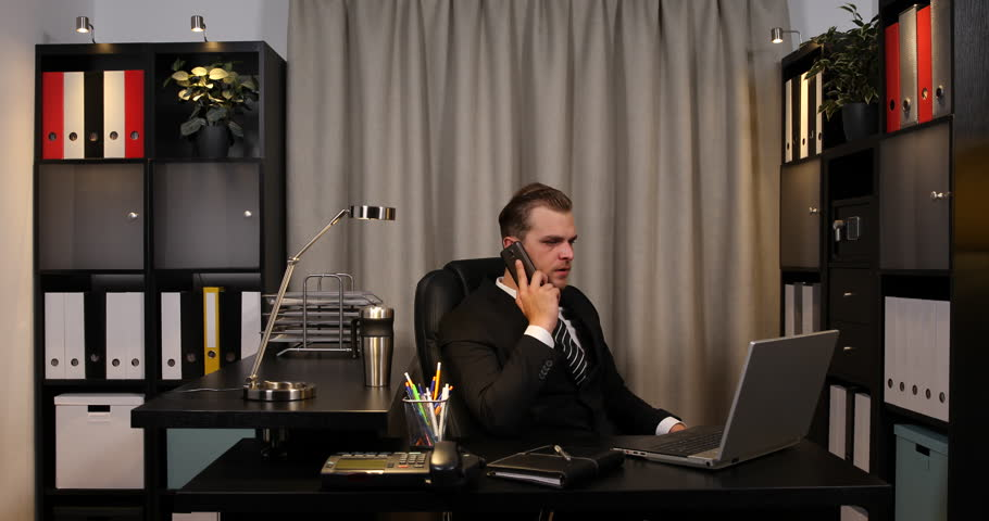Handsome Businessman Talking To A Mobile Phone Job Undone Office ...