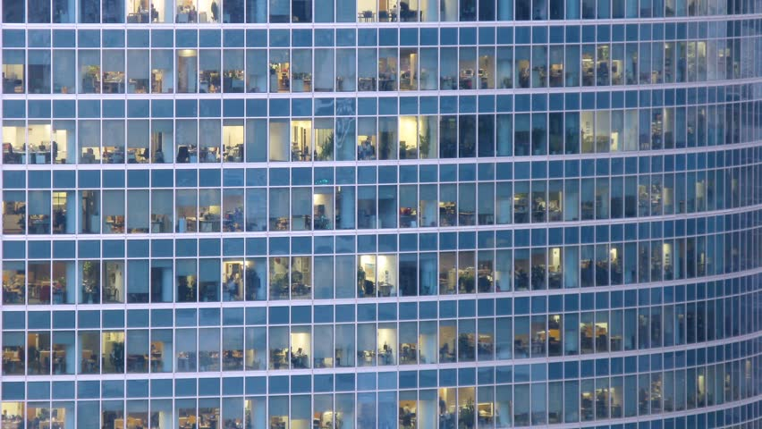 Office building viewed in the evening. Time lapse - HD stock footage clip