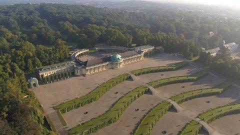4K Aerial of famous castle Sanssouci in Berlin, drone flight over green garden, warm sunset light, König Ludwig der 14.