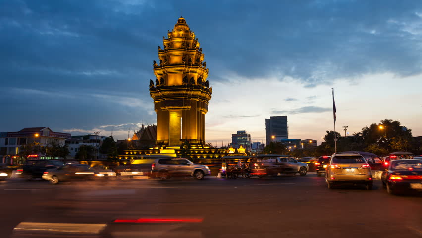 PHNOM PENH, CAMBODIA- DECEMBER 13, 2012: Sunset Timelapse of the Independence Monument in Phnom Penh, Cambodia at rush hour on December 13, 2012. Commuter traffic can be seen in the foreground.