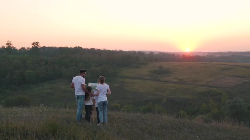 Happy family in the field at sunset. | Shutterstock HD Video #31551181
