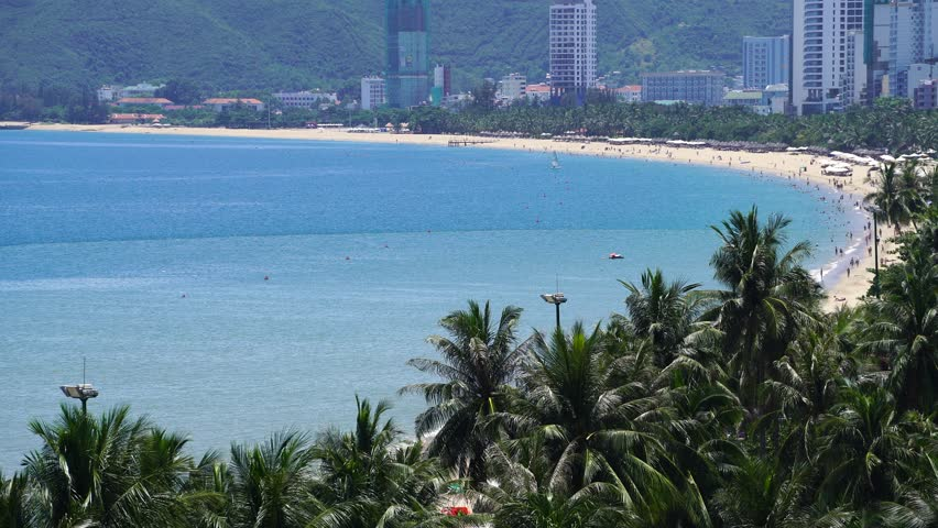 Beautiful view on Nha Trang and Nha Trang Bay of South China Sea with magic colors of water on blue sky background in Khanh Hoa province, Vietnam. Nha Trang is a popular tourist destination of Asia. | Shutterstock HD Video #31558804