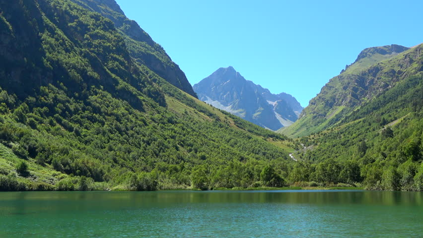 Lake scenes in mountains, national park Dombai, Caucasus, Russia, Europe. Summer landscape, sunshine weather, blue sky and sunny day, green trees. 4K footage, video camera format 3840x2160 | Shutterstock HD Video #31590991