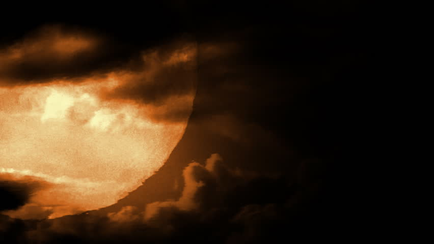 Full moon with dramatic time lapse clouds and air distortion.