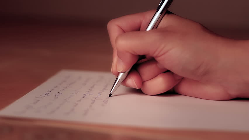 Female hand writing on a piece of paper with shallow depth of field. | Shutterstock HD Video #3161677