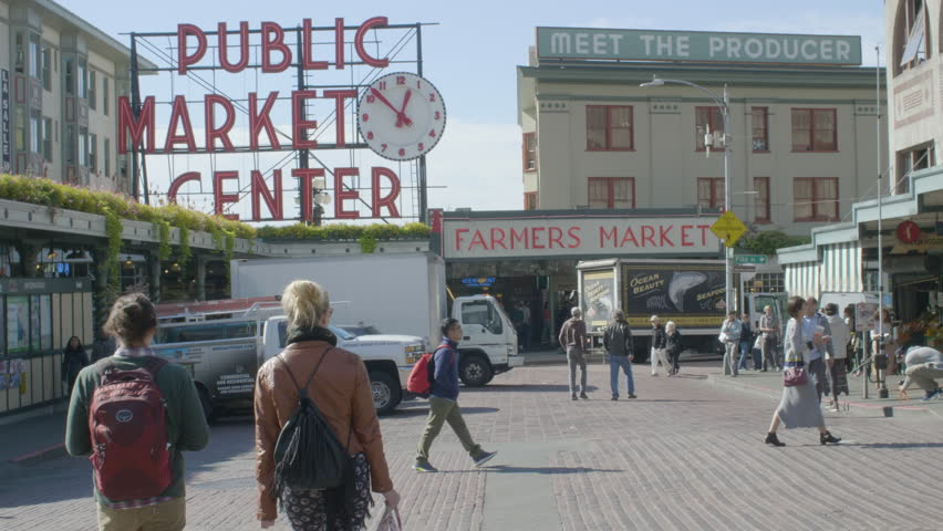 SEATTLE, WASHINGTON/USA - OCTOBER 4, 2017: Shoppers and Tourists Visit Pike Place Public Market Center a Famous Landmark With Seafood and Farmers Market