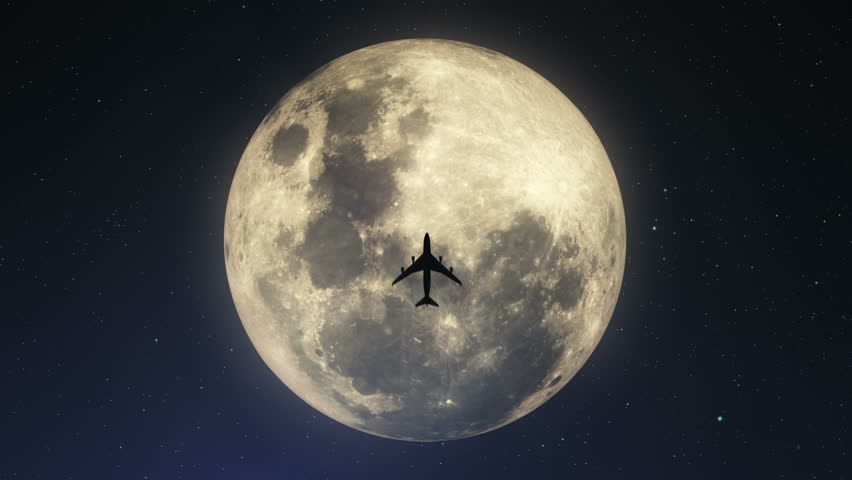 Silhouette of plane passing over super moon