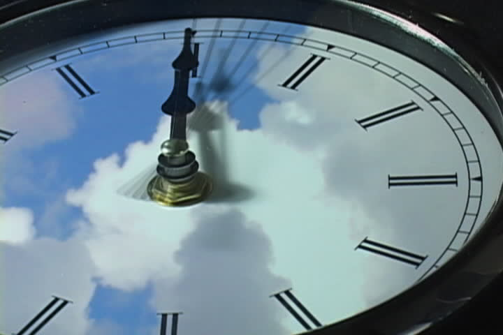 fast moving clouds over clock in time-lapse (loop)