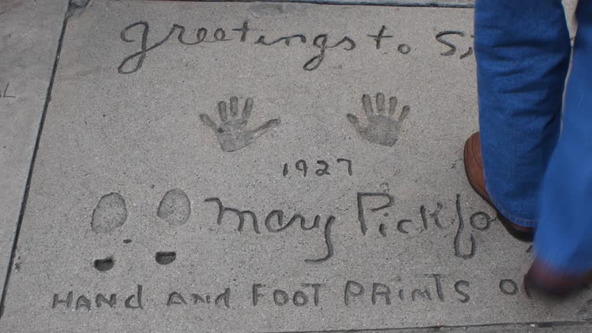 HOLLYWOOD, CA - CIRCA 2011: Boot prints and hand prints of Mary Pickford  at Graumann's Chinese Theater in Hollywood, California. | Shutterstock HD Video #3167671