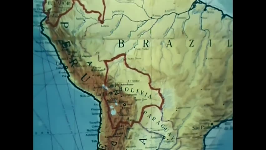 CIRCA 1960s - A presenter in an office with ancient masks and a map of South America talks about a Civic Action Program in Colombia, in 1964. | Shutterstock HD Video #31694371