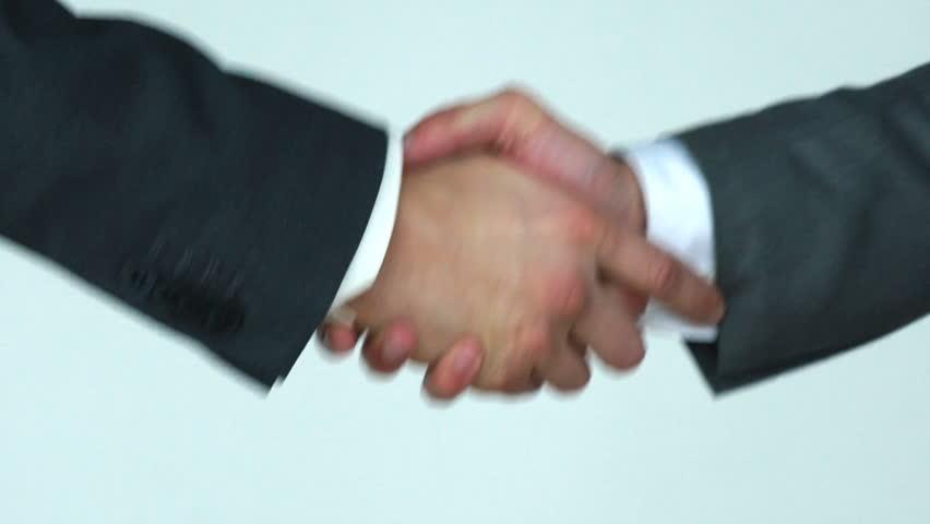 Two business men shaking hands slow motion | Shutterstock HD Video #31700971