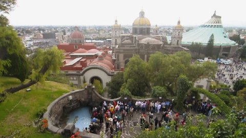 MEXICO CITY, MEXICO - DECEMBER 12, 2012: Thousands of faithful Catholics bless themselves with water from Tepeyac Hill during their to visit the Basilica of Our Lady of Guadalupe on December 12, 2012.