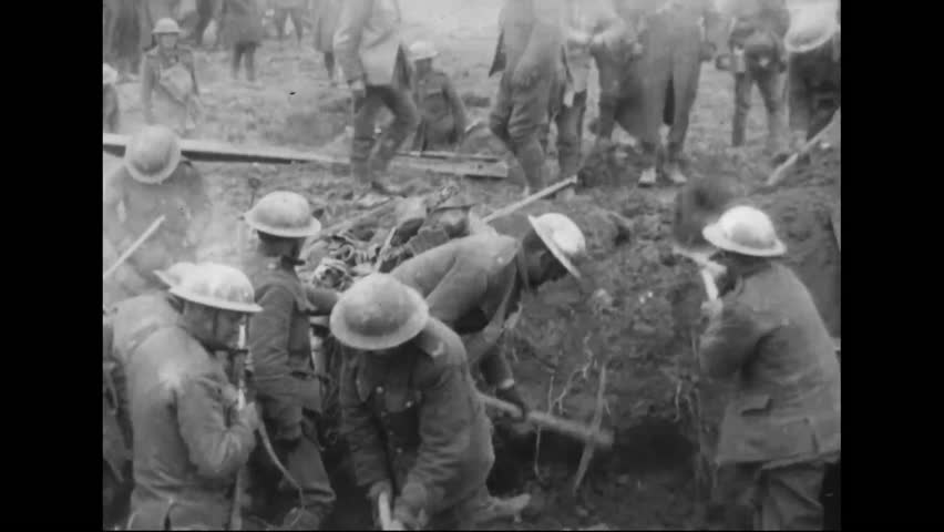 CIRCA 1918 - Captured German 5.9 inch guns, British soldiers in trenches and marching Australian troops are shown in France during World War 1.