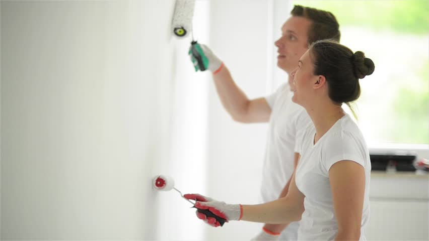 Happy Family Paints the Wall with White Paint. Repair in the Apartment Concept.   Shutterstock HD Video #31754956