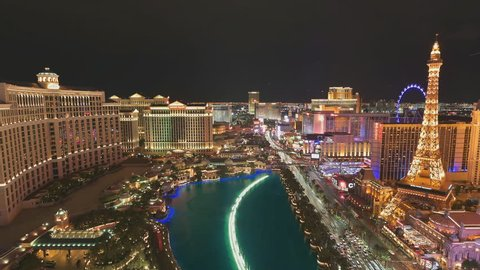 LAS VEGAS, NEVADA - July 25, 2017: Illumination of Las Vegas strip at night on July 25, 2017 in Las Vegas, Nevada. Bellagio fountains show, Eiffel Tower, Caesars Palace in Las Vegas Blvd. Time lapse.