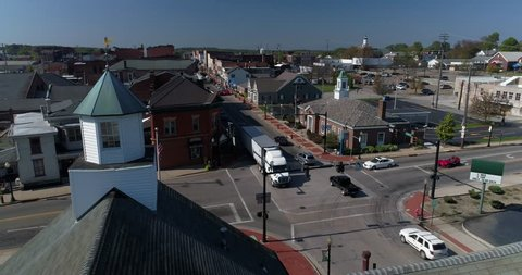 A laterally-moving daytime dolly aerial establishing shot of the small town of Salem, Ohio's business district.