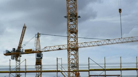 Berlin, Germany - September 11, 2017: Zublin Liebherr cranes on construction site. Züblin AG is one of the largest German construction companies with branches and subsidiaries in Germany and abroad