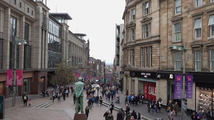 Glasgow, Scotland, UK; 15 October 2017: 4K video footage of pedestrians on Buchanan Street in Glasgow City Centre. Filmed over the statue of Donald Dewar.