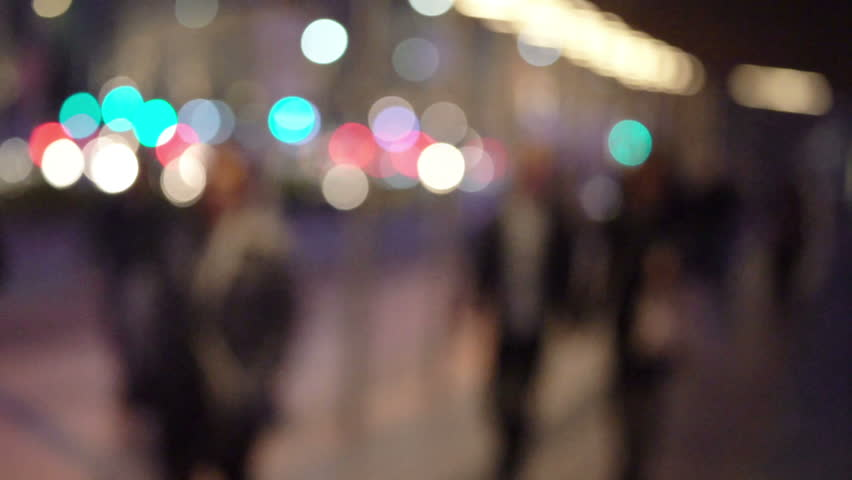 People walking in city night background.  Out of focus background from busy big city with people crossing street.    Shutterstock HD Video #31779181