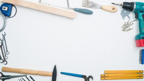 Top shot on DIY tools arranged on white background. 4k stop motion animation.