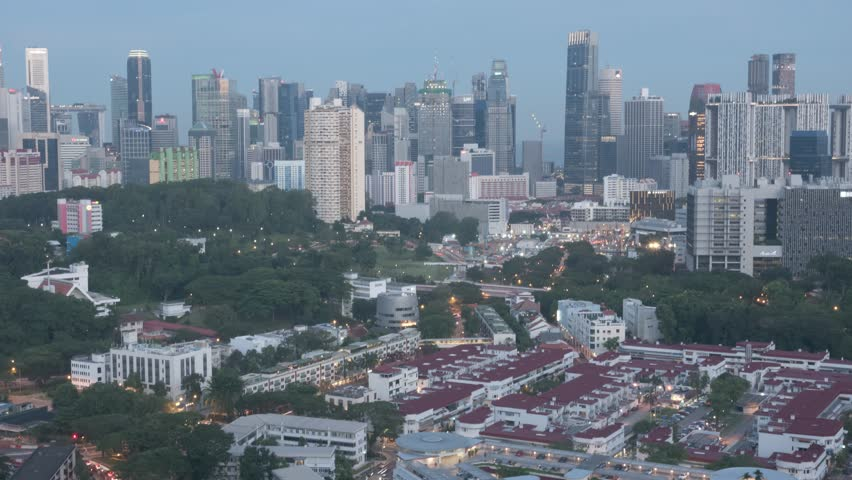 Sunset Timelapse of Singapore Skyline and Cityscape with long exposure light streaks, shot from central Singapore, Tiong Bahru