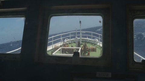 Fishing vessel navigation in rough sea from captain view