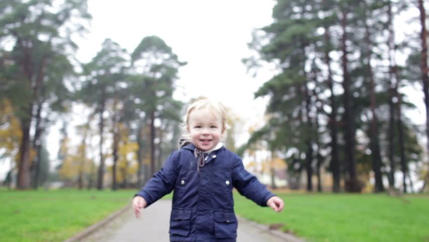 A little 2 year old boy is walking. Slow motion 50fr/sec