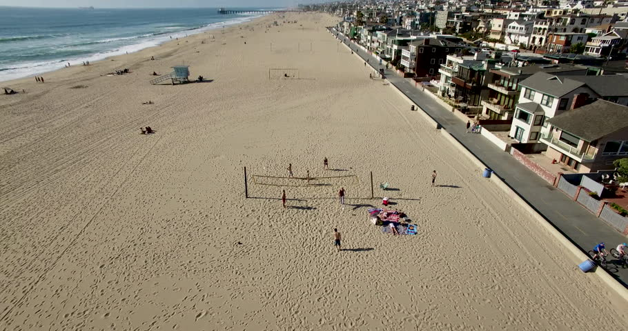 4k Aerial Around Friends Playing Beach Volleyball Hermosa California Zoom Out
