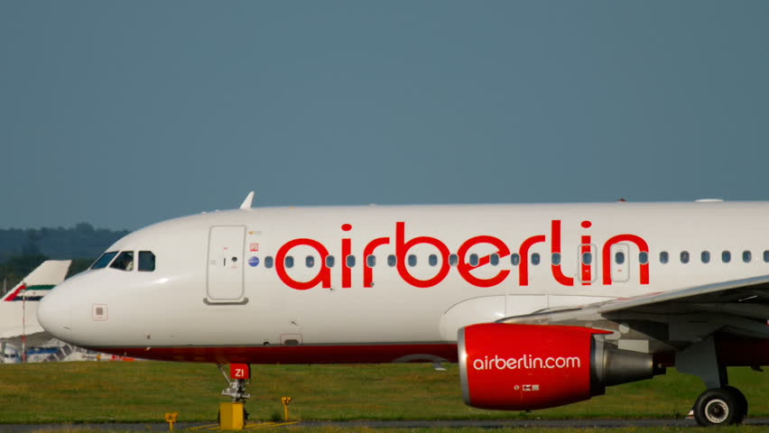 DUSSELDORF, GERMANY - JULY 21, 2017: Airberlin Airbus 320 D-ABZI taxiing to the start at sunset. Dusseldorf airport