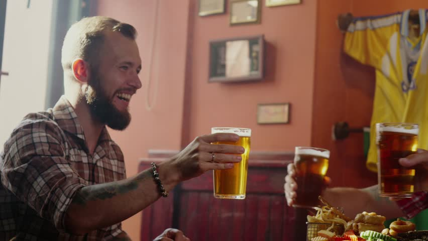 Good old friends drinking beer in pub | Shutterstock HD Video #32042011