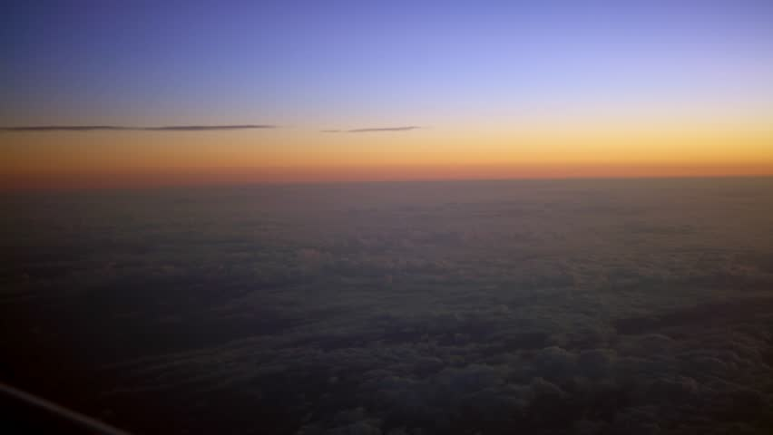4K Traveling by air. Beautiful view of the sky and clouds with the sun from above, as seen through an airplane window in dawn sun | Shutterstock HD Video #32054200