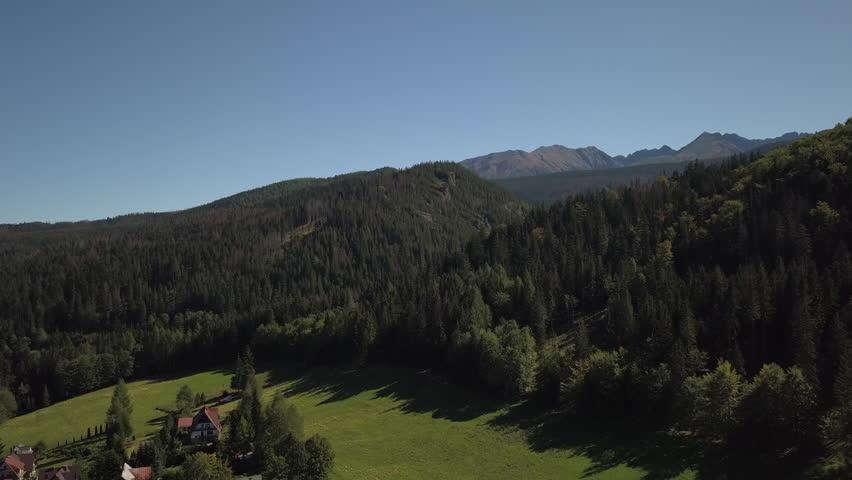 4K Aerial: Reveal shot of Tatra Mountains in Zakopane, Poland.