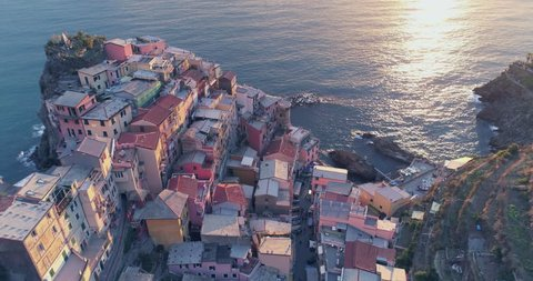 Amazing aerial view of Manarola village on cliff rocks and turquoise sea.Stunning view of beautiful and cozy town in Cinque Terre Reserve,Liguria,Italy,Europe.Travel destination, adventure concept.