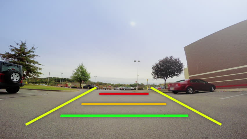 A car's backup camera in action. Simulated video feed with warning lines as objects get closer.   Shutterstock HD Video #32084851
