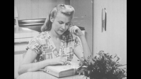 1950s: Woman sits at kitchen table, flips through book, looks thoughtful. Woman stands at kitchen counter, puts butter into bowl, looks at book.