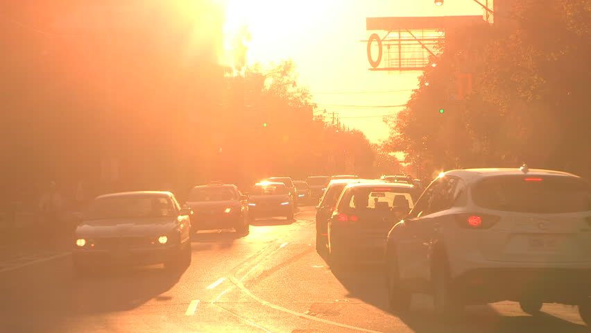 Toronto, Ontario, Canada October 2017 Fireball orange sunset blinding drivers and traffic on city street | Shutterstock HD Video #32105779