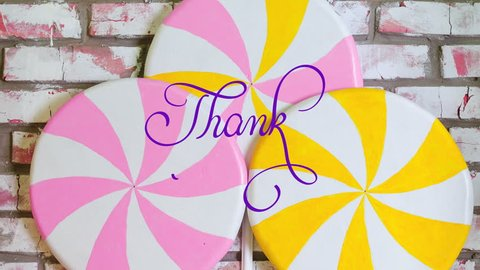 Written animation Thank you calligraphy lettering text with Ornate frame elements on pink and yellow candys background. Filigree divider animation words