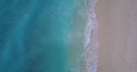 v10015 waves water texture breaking and crashing with drone aerial flying view of aqua blue and green clear sea ocean