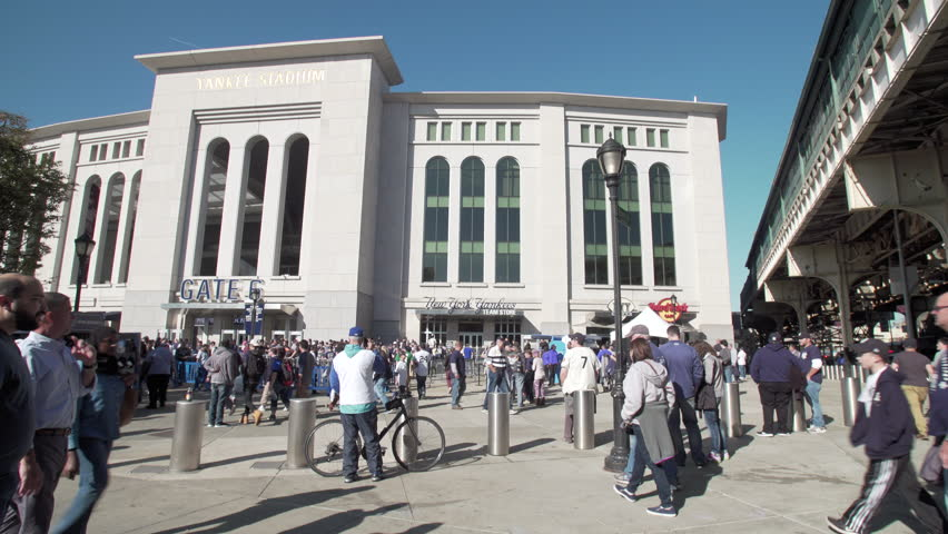 BRONX, NEW YORK CITY - OCTOBER 18, 2017: View of Yankee Stadium from River Avenue at Yankee stadium as fans get ready for Yankees Bronx Bombers play the Houston Astros in ALCS playoffs Game 5 night
